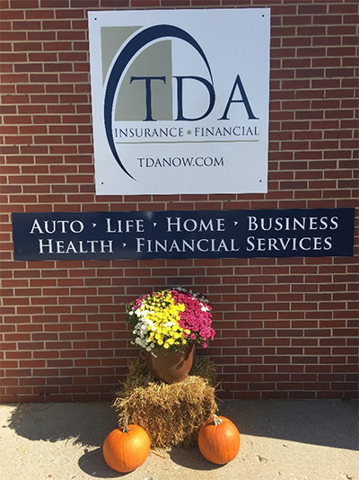 TDA sign with flowers and pumpkins